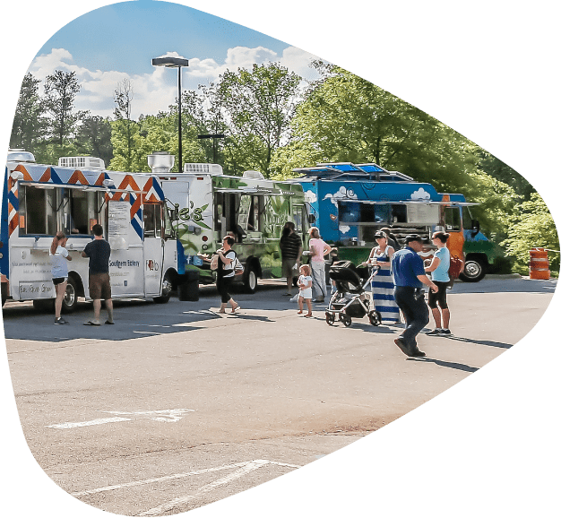 food-truck-park-with-various-food-trucks-and-customers-visiting-them