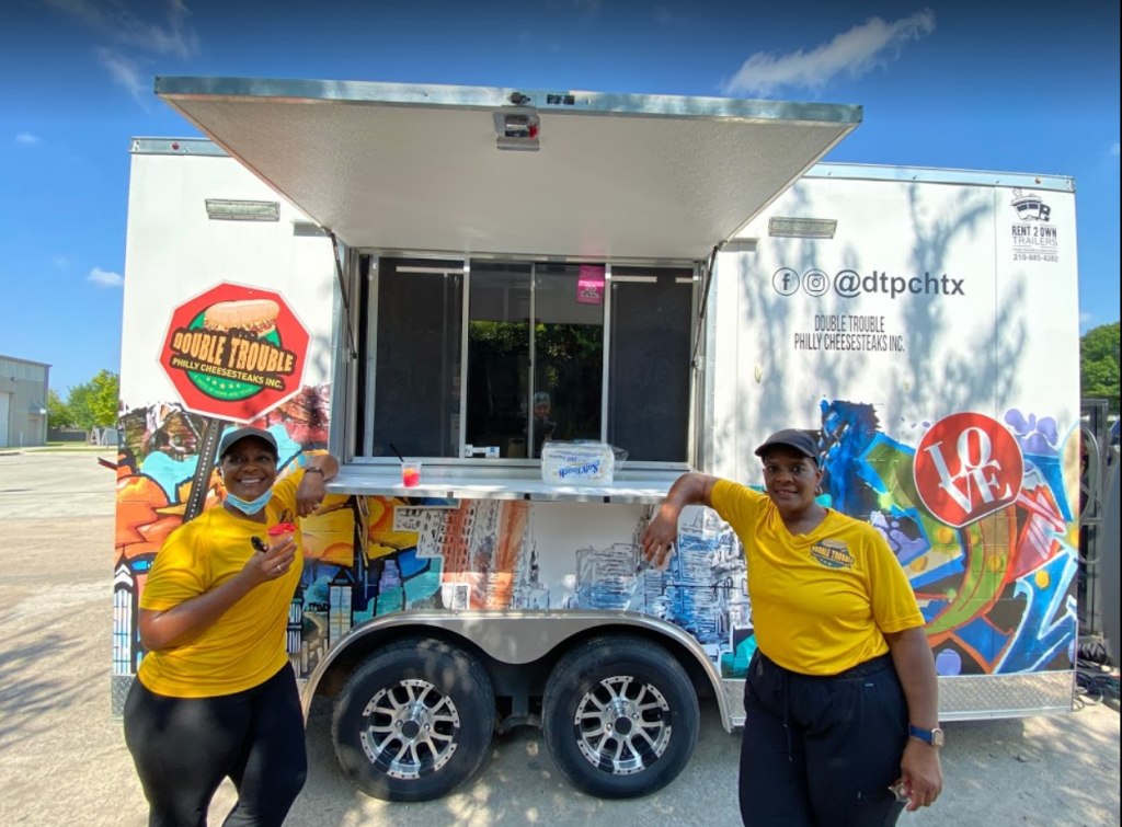 happy-clients-with-their-new-food-trailer