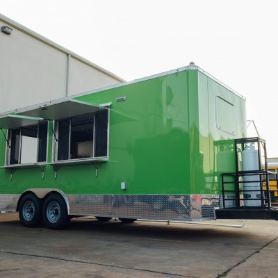 side-of-green-food-trailer-with-two-service-windows-made-by-trailer-king-builders